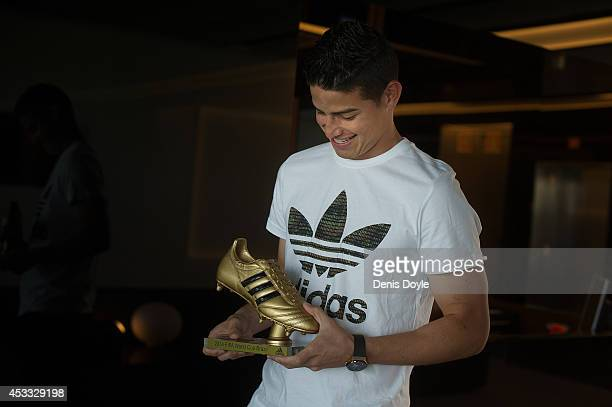 Footballer James Rodriguez receives his adidas Golden Boot Trophy at Real Madrid's Valdebebas in recognition of scoring the most goals during the...