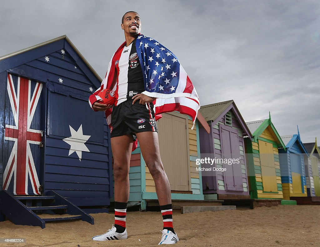 Footballer Jason Holmes of the St.Kilda Saints poses at Brighton Beach on August 21, 2015 in Melbourne, Australia. Holmes will the first born and raised American to play in the AFL against the Geelong Cats on Saturday night at Etihad Stadium.
