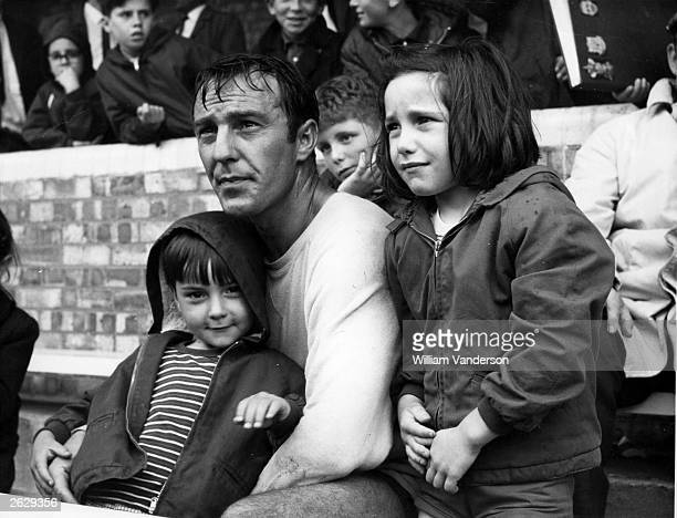 Footballer Jimmy Greaves of Tottenham Hotspur watches a football match with his children. Original Publication: People Disc - HF0491