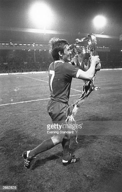 Footballer Kenny Dalglish holds the European trophy after scoring the winning goal in his team Liverpool 1 0 victory over Bruges to win the European...