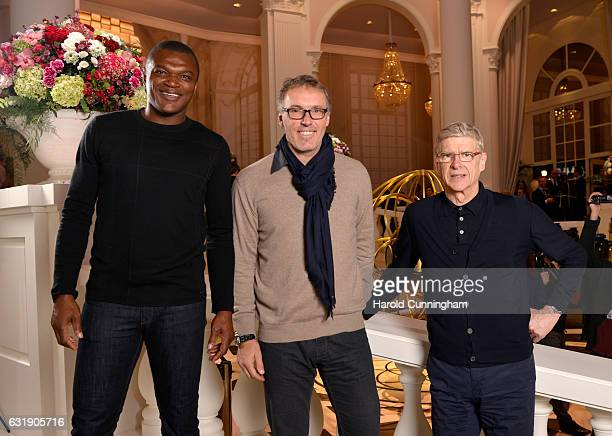Footballer Marcel Desailly football managers Laurent Blanc and Arsene Wenger visit the IWC booth during the launch of the Da Vinci Novelties from the...