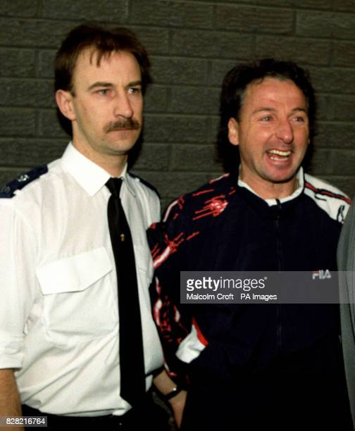 Footballer Mickey Thomas of Wrexham finds something to laugh about after appearing on a charge of distributing counterfeit currency