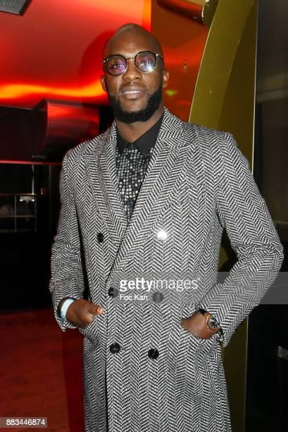 Footballer Momo Sissoko attends 'Les Diamants de L'Orient' Nadia Toure Streetwear Fashion Show at VIP Room Theater Club on November 30 2017 in Paris...
