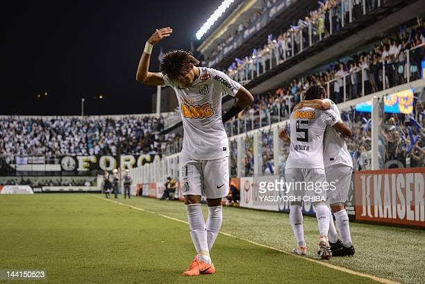 Footballer Neymar , of Brazilian team Santos, makes a bow to the fans after scoring against Bolivia's Bolivar during a Libertadores Cup match at Vila...