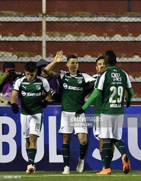Footballer Nicolas Benedetti of Deportivo Cali of Colombia celebrates with teammates after scoring against Bolivar of Bolivia during a Copa...