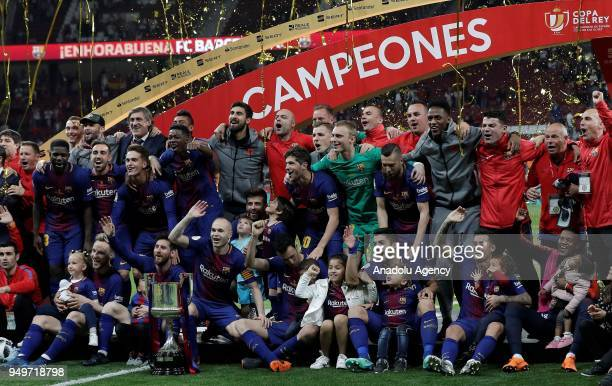 Footballer of Barcelona celebrate with the trophy after Copa del Rey Final soccer match between Sevilla and Barcelona at Wanda Metropolitano Stadium...