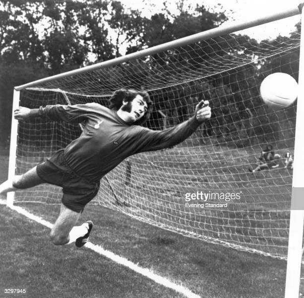 Footballer Pat Jennings of Tottenham Hotspur dives for a ball