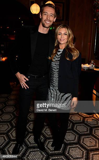 Footballer Peter Crouch and his wife model Abbey Clancy attend the LOVE x Balmain Xmas Party at The Ivy Market Grill on December 15 2014 in London...
