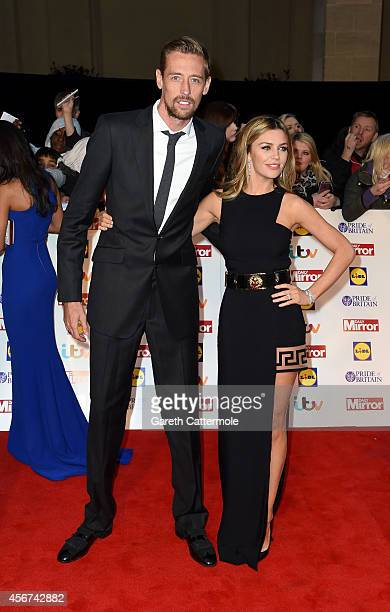 Footballer Peter Crouch and wife Abbey Clancy attend the Pride of Britain awards at The Grosvenor House Hotel on October 6 2014 in London England