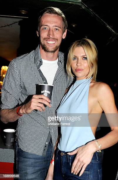 Footballer Peter Crouch and wife model Abbey Clancy are spotted in the audience watching Miles Kane perform at Zanzibar Club for Jack Daniels Roots...