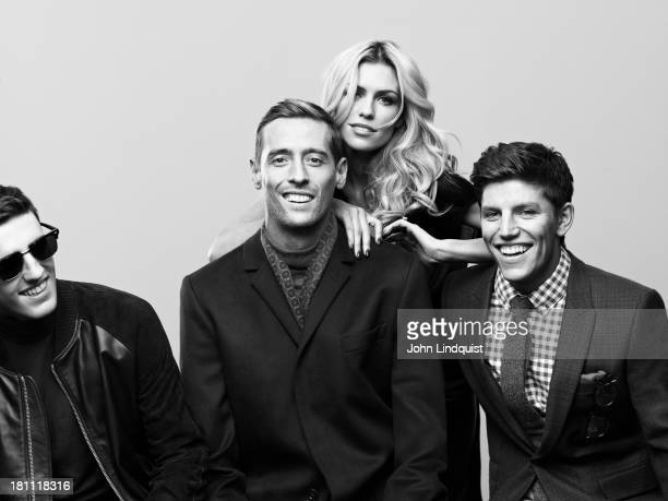Footballer Peter Crouch with model Abbey Clancy and her brothers Sean and John Clancy are photographed for Mr Porter on October 28 2011 in London...