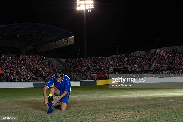 footballer pulling up sock - adjust socks stock pictures, royalty-free photos & images