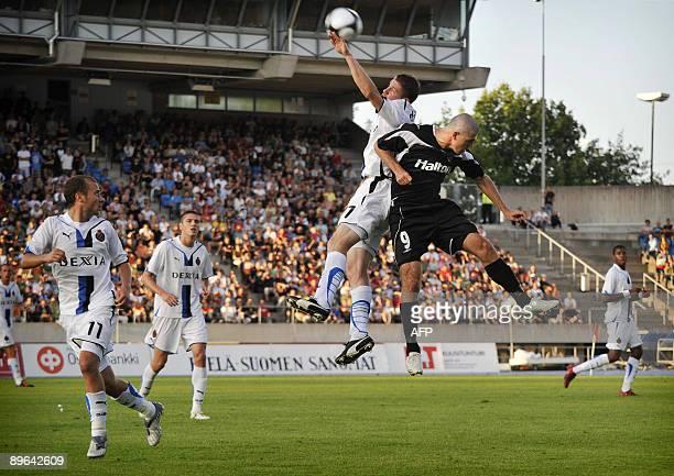 Footballer Rafael of FC Lahti vies for the ball against Club Brugge's Koen Daerden during their 3rd round European League qualifying match in Lahti,...