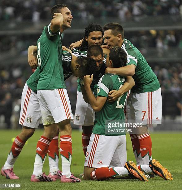Footballer Raul Jimenez of Mexico celebrates with teammates after scoring the second goal of the team against Panama during the Brazil 2014 FIFA...