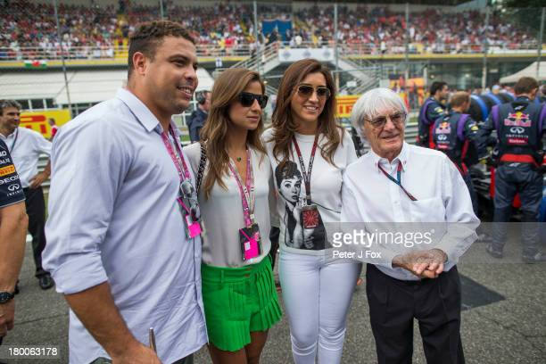 Footballer Ronaldo of Brazil with Fabiana Flosi of Brazil who is the Wife of Bernie Ecclestone of Great Britain who is standing next to her during...