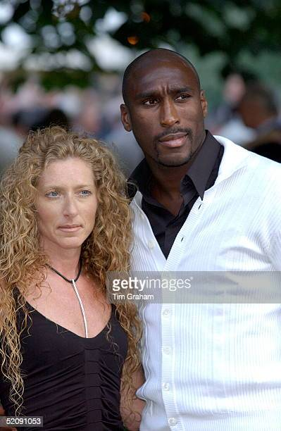 Footballer Sol Campbell With His Girlfriend Kelly Hoppen At A Celebrity Party Hosted By Broadcaster Sir David Frost In Chelsea