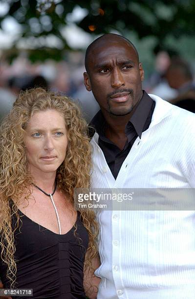 Footballer Sol Campbell with his girlfriend Kelly Hoppen attend a celebrity party hosted by broadcaster Sir David Frost in Chelsea