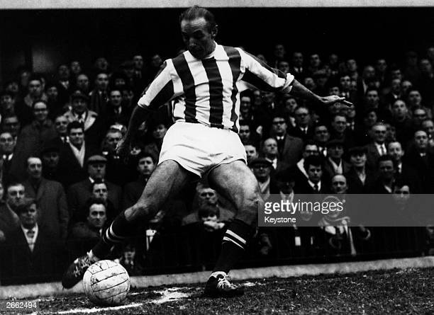 Footballer Stanley Matthews taking a corner during a match for Stoke City against Fulham