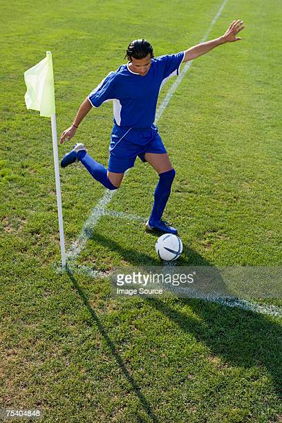 footballer taking a corner kick - corner kick stock pictures, royalty-free photos & images