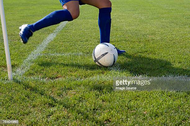 Footballer taking a corner kick