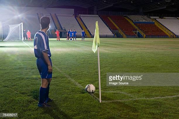 footballer taking a corner kick - corner marking stock pictures, royalty-free photos & images