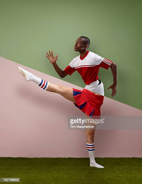 footballer top, cheer leader bottom - black cheerleaders stock photos and pictures