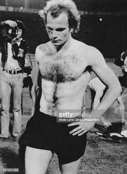Footballer Uli Hoeness of West Germany leaves the field after missing his penalty kick against Czechoslovakia at the end of the UEFA European...