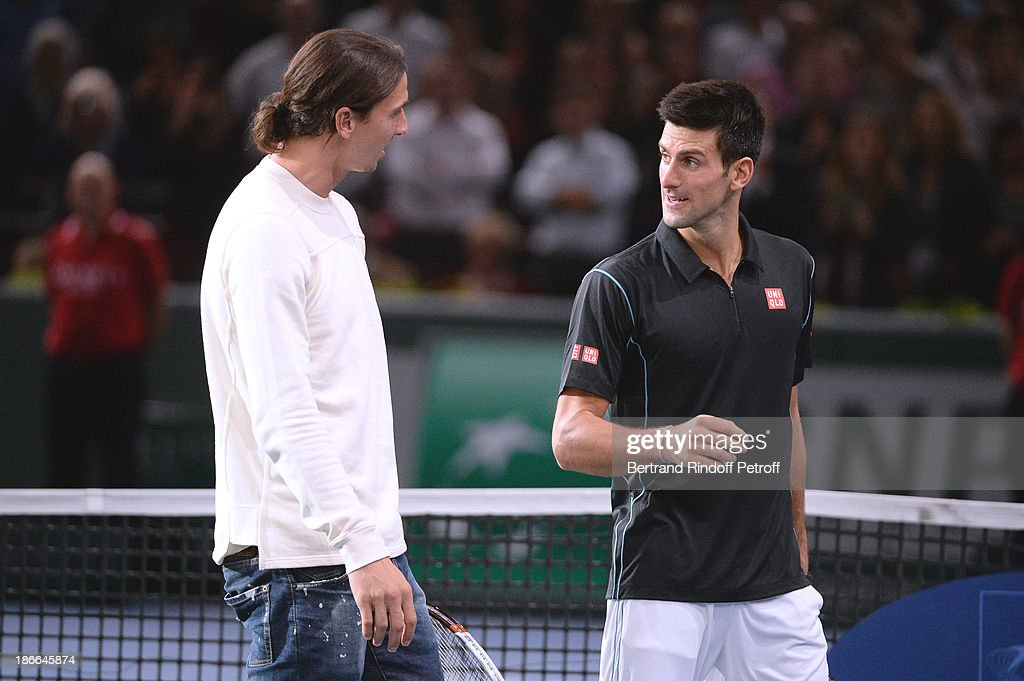 Footballer Zlatan Ibrahimovic with Novak Djokovic of Serbia after the match against Roger Federer during day six of the BNP Paribas Tennis Masters, held at Bercy on November 2, 2013 in Paris, France.