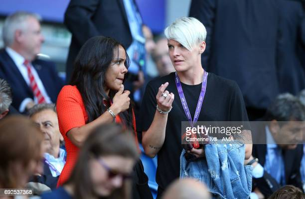Footballers Alex Scott and Nilla Fischer in the stand during the UEFA Women's Champions League Final match between Lyon and Paris Saint Germain at...
