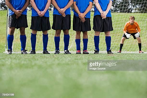 Footballers and goalkeeper