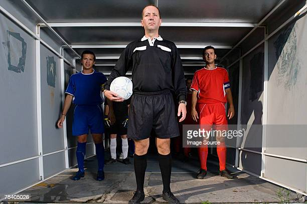 footballers and referee in a tunnel - referee stock photos and pictures