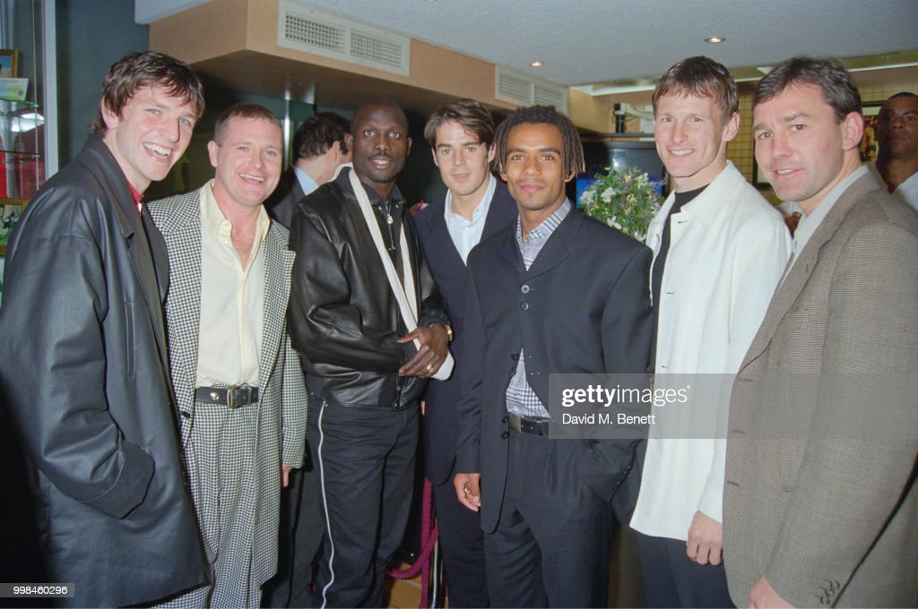 Footballers at the opening of the Football Football sports bar on Haymarket, London, 25th March 1996. Left to right: Lee Sharp, Paul Gascoigne, unidentified, Jamie Redknapp, Trevor Sinclair, Teddy Sheringham and Bryan Robson.