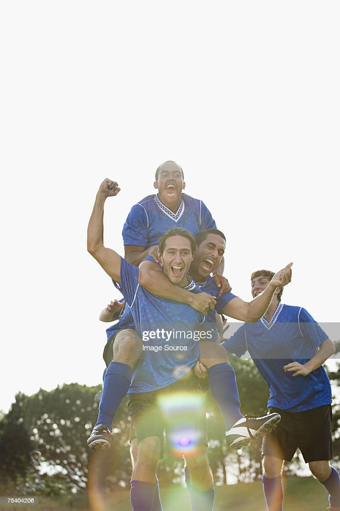 Footballers celebrating : Stock Photo