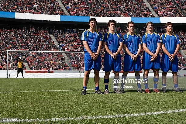 footballers defending a free kick - defender soccer player stock photos and pictures