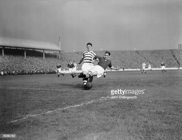 Footballers Evans of Celtic and Cox of Glasgow Rangers compete for the ball during a derby match at Ibrox Stadium Glasgow Large crowds gather for the...