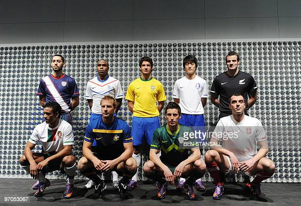 Footballers from some countries which have qualified for the 2010 world Cup in South Africa pose for pictures in their respective team kits during a...