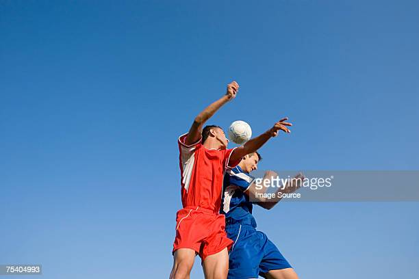 footballers heading football - heading the ball stock pictures, royalty-free photos & images