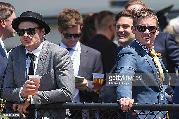 AFL footballers Heath Shaw of the Greater Western Sydney Giants and his friend Dayne Beams of the Brisbane Lions look on during Cox Plate Day at...