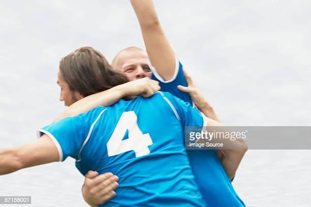Footballers hugging