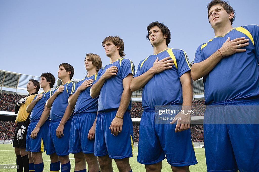 Footballers in a row : Stock Photo