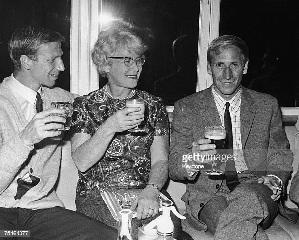 Footballers Jack and Bobby Charlton and their mother Elizabeth celebrating England's World Cup semi final victory over Portugal at the team hotel in...