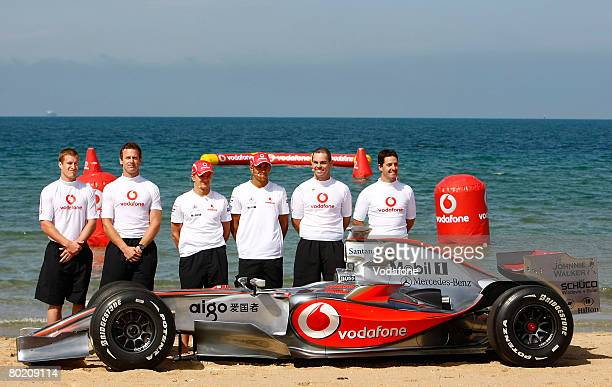 Footballers Luke Power, Adam Simpson, Heikki Kovalainen and Lewis Hamilton of the Vodafone McLaren Mercedes and V8 Supercar drivers Craig Lowndes and...