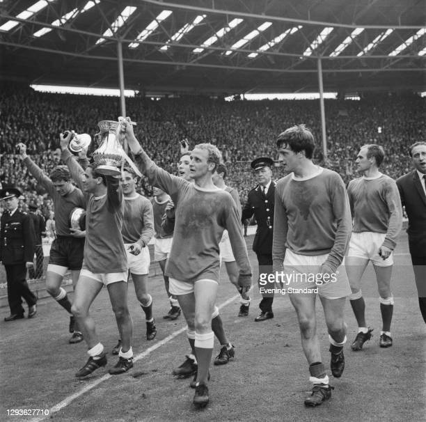 Footballers Mike Trebilcock and Alex Young of Everton FC hold up the FA Cup after the final against Sheffield Wednesday at Wembley Stadium, London,...