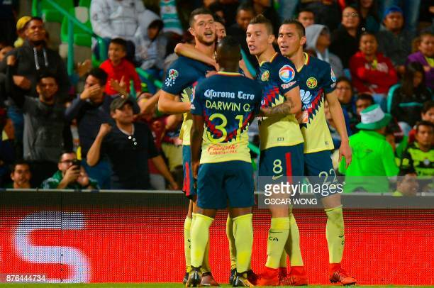 Footballers of America celebrate their goal against Santos during the Mexican Apertura tournament football match in Torreon Mexico on November 19...
