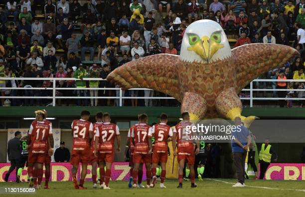 Footballers of Argentinos Junior leave the pitch through an inflatable tunnel depicting a falcon in allusion to Defensa y Justicia's nickname The...