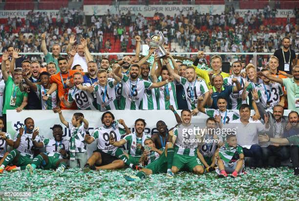 Footballers of Atiker Konyaspor raise the trophy after their victory at the end of the Turkcell Super Cup match between Besiktas and Atiker Konyaspor...