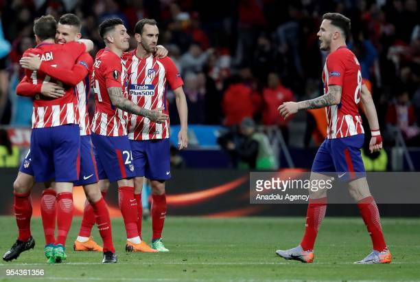 Footballers of Atletico Madrid celebrate their victory at the end of the UEFA Europa League semi final return match between Atletico Madrid and...