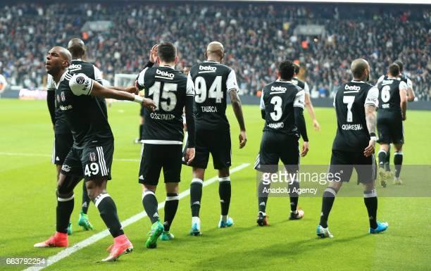 Footballers of Besiktas celebrate after scoring a goal during the Turkish Spor Toto Super Lig football match between Besiktas and Genclerbirligi at...