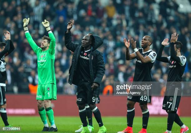 Footballers of Besiktas greet their fans after their victory at the end of the Turkish Spor Toto Super Lig football match between Besiktas and...