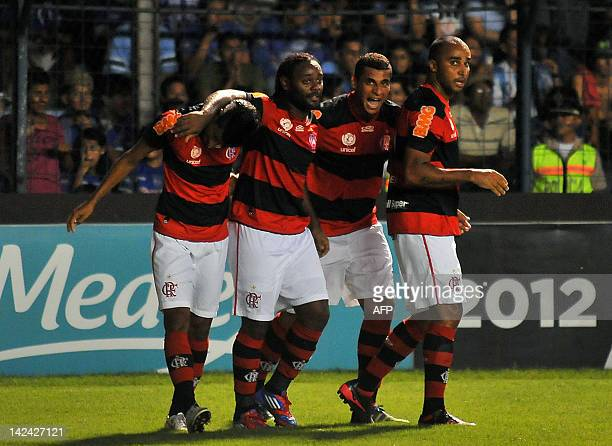 Footballers of Brazil's Flamengo celebrate after scoring against Ecuador's Emelec during their Copa Libertadores football match at the George Capwell...